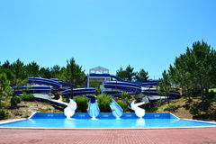 Aqua Park Slides. Swimming pool on a pine tree hill Royalty Free Stock Image