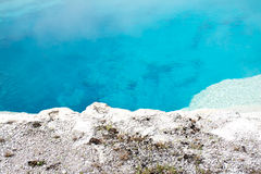 Aqua Pool White Shoreline. This was an aqua blue hot spring at Yellowstone National Park. The crust and rocks around the hot spring were white in color creating Stock Photos