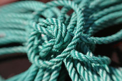 Aqua rope. Knotted aqua ship's rope with limited depth of field Stock Photography