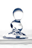 Aqua Sculpture Droplets Collision. Water Drop Impact On The Liquid Surface White Background Stock Photography