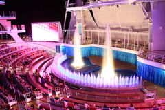 Aqua Theater onboard Oasis Of the Seas. The beautiful outdoor Aqua Theater on board the biggest cruise ship in the world Oasis of the seas owned by Royal Stock Photography