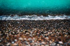 Aqua tidal beach with pebble Stock Images