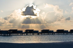 Aqua villas in sun rays before sunset Stock Images