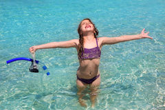 Aqua water beach and open arms bikini little girl Stock Photos