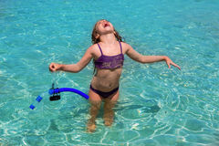 Aqua water beach and open arms bikini little girl Stock Photo
