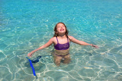 Aqua water beach and open arms bikini little girl Royalty Free Stock Images
