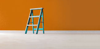 Aqua wooden ladder on yellow background Stock Photo