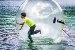 Aqua zorbing on water Royalty Free Stock Photography