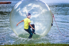 Aqua zorbing on water Royalty Free Stock Images