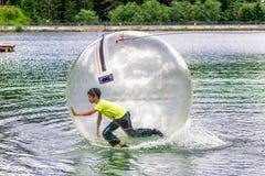 Aqua zorbing on water. Aquazorbing. Aqua zorbing on water reservoir Hrabovo in town Ruzomberok, Slovakia. Summer 2017 royalty free stock photography