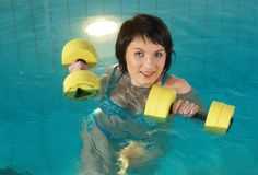 Aquaaerobic girl Stock Images