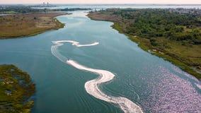141 aquabikers. 4k. Aerial view. waves water aquabike stock video