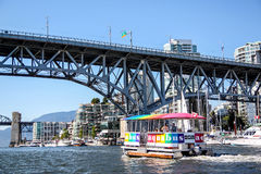 Aquabus Ferry Approaches Granville Island Bridge Royalty Free Stock Photography