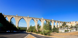 Aquaduct panorama. Beautiful wide angle panorama of the Aguas Livres Aqueduct in Lisbon, Portugal royalty free stock photography