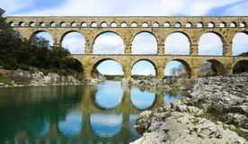 Aquaeduct Pont du Gard south of France. Reflections of Pont du Gard, an 2000 years old Roman Aquaeduct in the south of France, Departement Gard, Languedoc Royalty Free Stock Photography