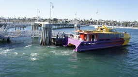 Aqualink ll - The Barge. The barge Aqualink ll is now leaving to transport passengers to an island Stock Image