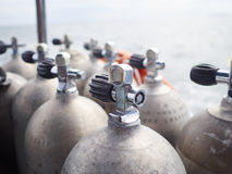 Aqualung. Row of oxigen tanks for scuba diving Royalty Free Stock Images