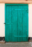 The Aquamarin Old Vintage Door with Crack Paint and Big Steel Bolt Stock Photo