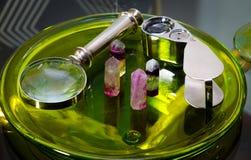 Aquamarine with magnify glass. Aquamarine crystal minirals gems with magnify glass Stock Image