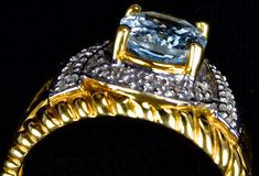Aquamarine Capped Gold Ring with Diamonds royalty free stock photo