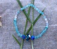 Aquamarine Gemstone Bracelet. Hand Made bracelet Blue Aquamarine on a linen background Royalty Free Stock Photo