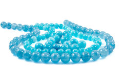 Aquamarine natural crystals gem beads isolated on white background Royalty Free Stock Photo