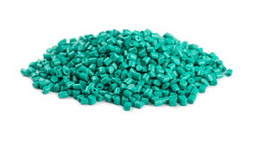 Aquamarine plastic polymer granules. Pile of aquamarine plastic polymer granules isolated on white background Royalty Free Stock Image