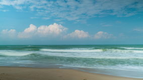 Aquamarine sea tide and clouds time lapse video. Clip stock video footage