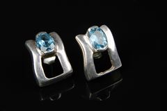 Aquamarine in silver  earring Royalty Free Stock Photos