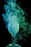 Aquamarine smoke in a glass. Halloween. Stock Photography