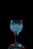Aquamarine smoke in a glass. Halloween. Royalty Free Stock Photography