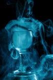 Aquamarine smoke in a glass. Halloween. Stock Image
