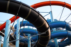 Aquapark. Twisting, colorful water chutes wind around Royalty Free Stock Photography