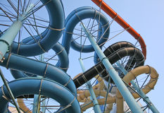 Aquapark. Twisting, colorful water chutes wind around Royalty Free Stock Image