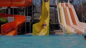 Aquapark. A man is riding a water slide stock footage