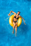 Aquapark. Playing in the pool. Beauty Brunette at Water Park Stock Images