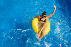 Aquapark. Playing in the pool. Beauty Brunette at Water Park Royalty Free Stock Photography