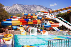 Aquapark sliders with Mountain Stock Images