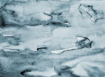 Aquarela cinzenta abstrata na textura de papel como o fundo fotos de stock royalty free