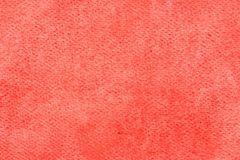 Aquarela vermelha pintada no macro da textura do fundo do papel fotografia de stock royalty free