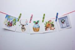 Aquarell-Weihnachtskarten auf einem weißen Hintergrund Stockfotografie