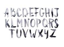 Aquarellaquarell-Gussart handgeschriebene Hand gezeichnete Gekritzel-ABC-Alphabetversalienbuchstaben Stockfoto