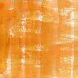 Aquarellbeschaffenheit einer transparenten orange, braunen Farbe Abbildung Abstrakter Hintergrund des Aquarells, Stellen, Unschär Stockbild