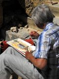 Aquarelle aînée de peinture de dame images libres de droits