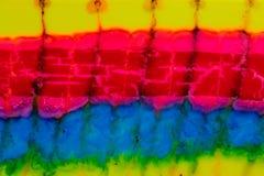 Aquarelle avec les lignes rouges, jaunes et bleues Photographie stock libre de droits