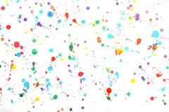 Aquarelle de chiquenaude de couleur par le pinceau photos libres de droits