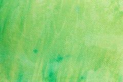 Aquarelle verte peinte sur la texture de papier de fond Photographie stock