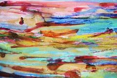 Aquarellfarbenfarben und rotes Wachs, abstrakter Hintergrund Stockfotografie