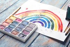 Aquarellmalerei des Regenbogens auf Hintergrund Lizenzfreie Stockbilder