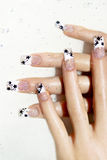 Aquarium design on transparent nails. Aquarium design on transparent nails with black stars inside acrylic and sparkles in the water royalty free stock images